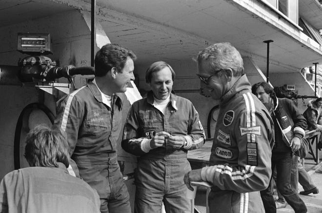 The Whittingtons, Don (left) and Bill (center) chat with actor/racer Paul Newman at Le Mans, 1979.