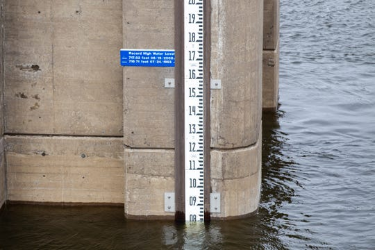 A water mark is seen on a control tower below the 2008 and 1993 flood high point levels on Wednesday, Oct. 10, 2018, at the Coralville Lake dam.