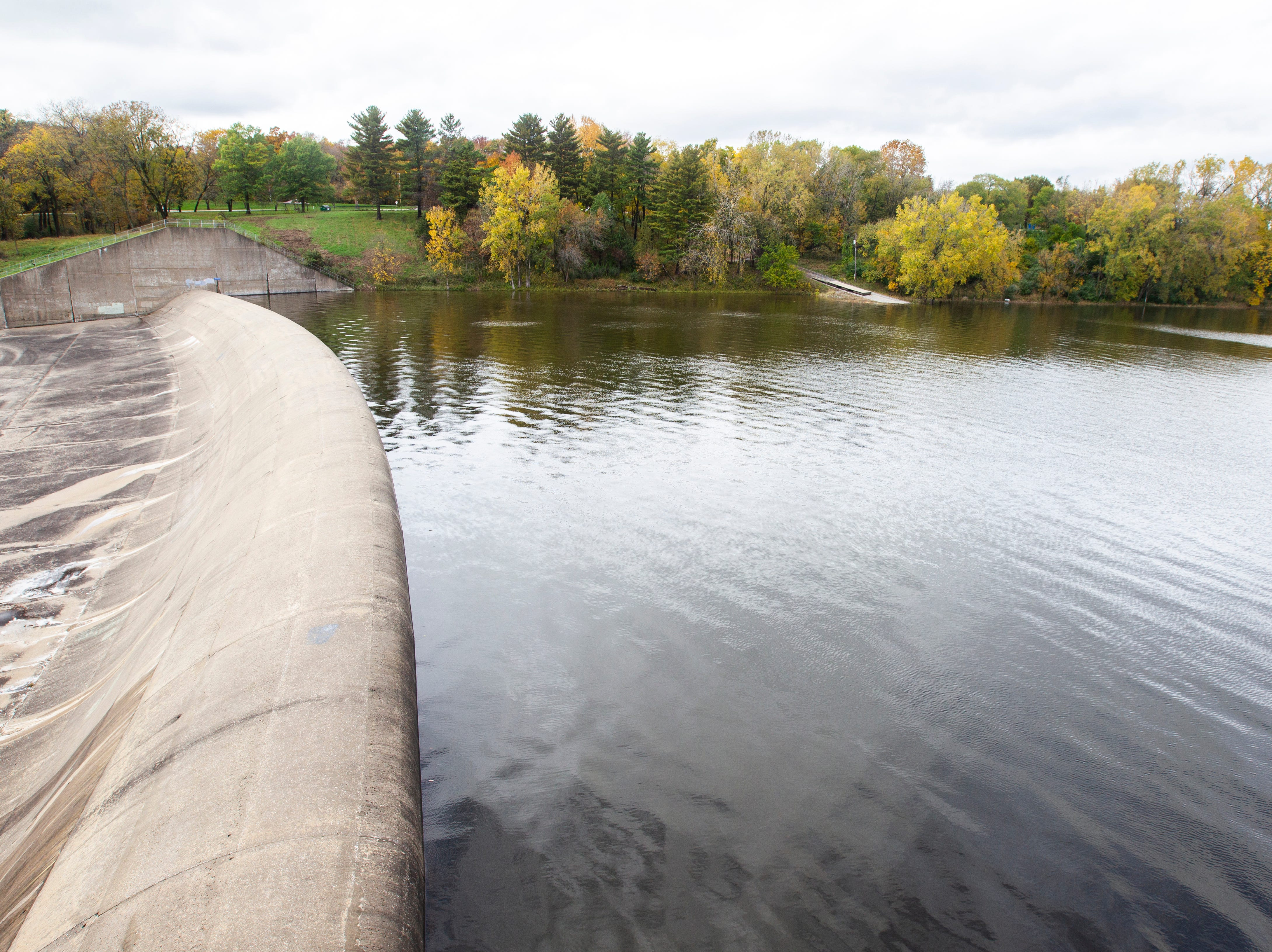 Water raises out past the beach towards the emergency spillway on Wednesday, Oct. 10, 2018, at the Coralville Lake dam.
