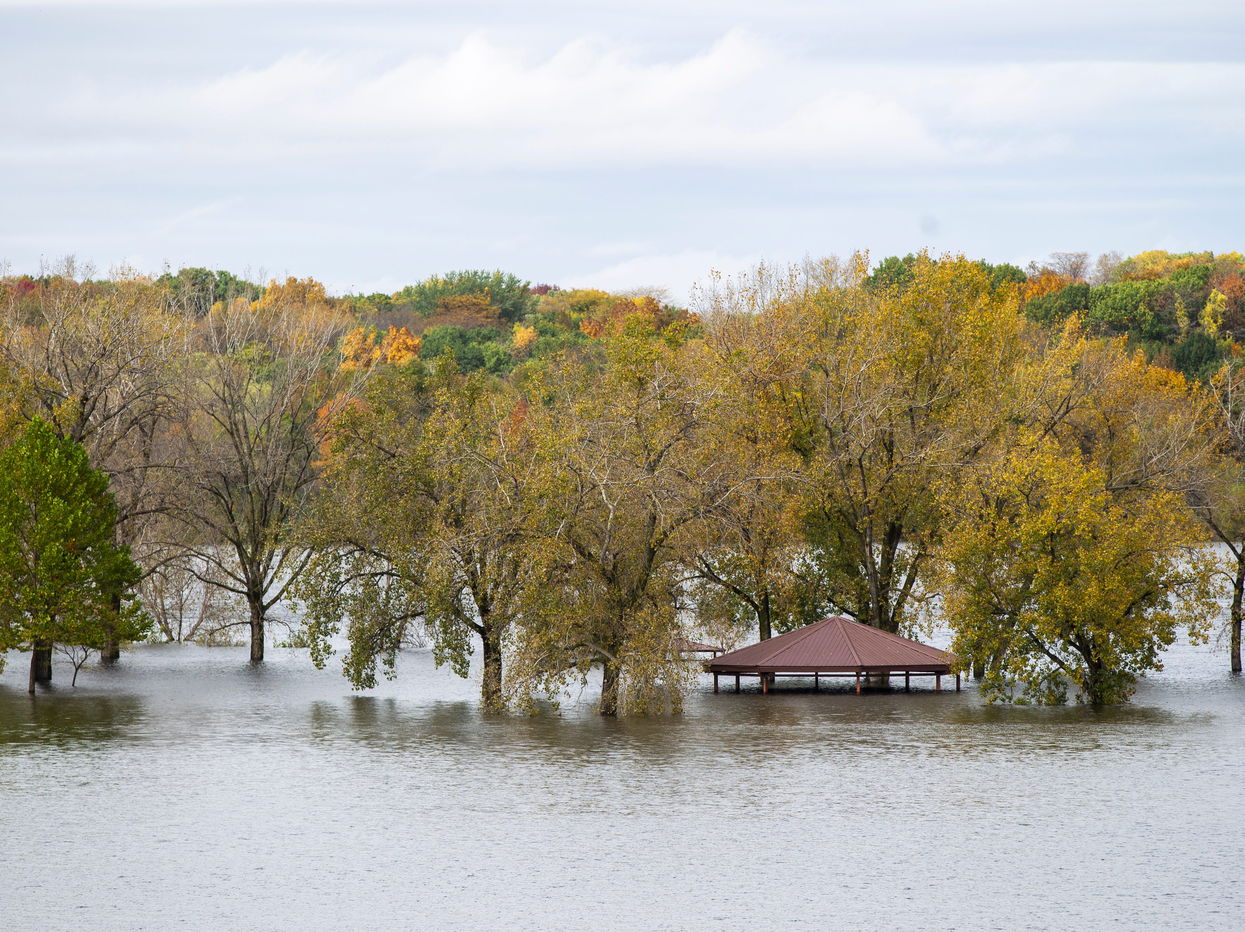 Water raises out past the beach to surround a pavilion on Wednesday, Oct. 10, 2018, at the Coralville Lake dam.