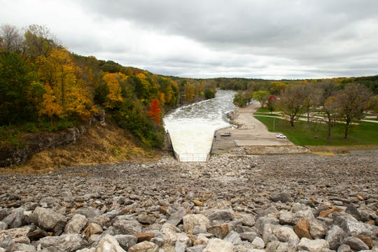 Water flows out at 12,000 cubic feet per second on Wednesday, Oct. 10, 2018, at the Coralville Lake dam.