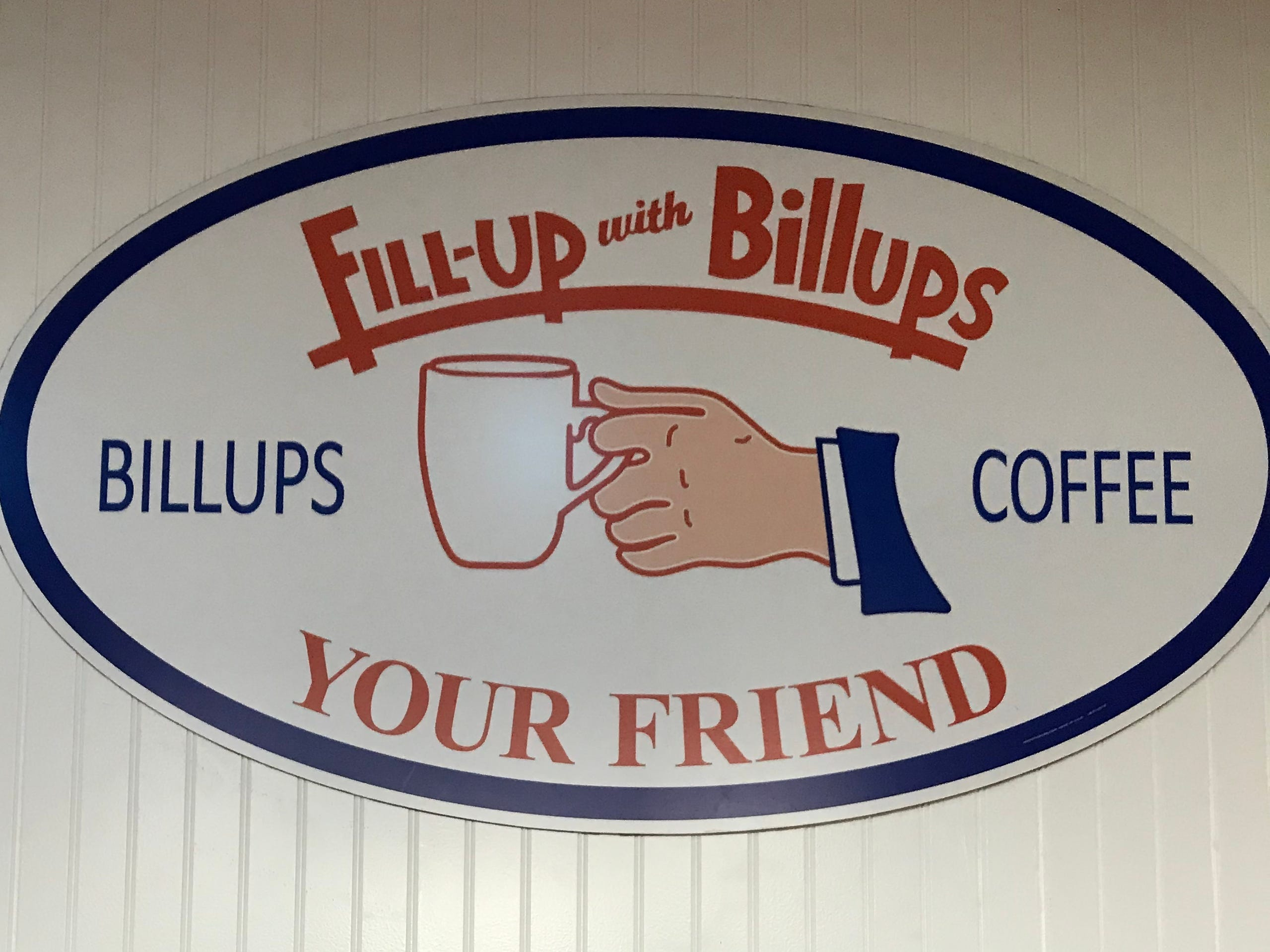A vintage-style sign welcomes guests to Fill-Up with Billups in Madison.