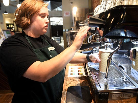 McKenzie Lynn prepares a latte for a customer at The Coffee Shop in downtown Humboldt. The shop opened in September 2018.