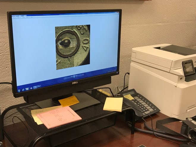 Software at the Jackson Police Department's ballistics lab allows analysts to compare microscopic indentations on shell casings.
