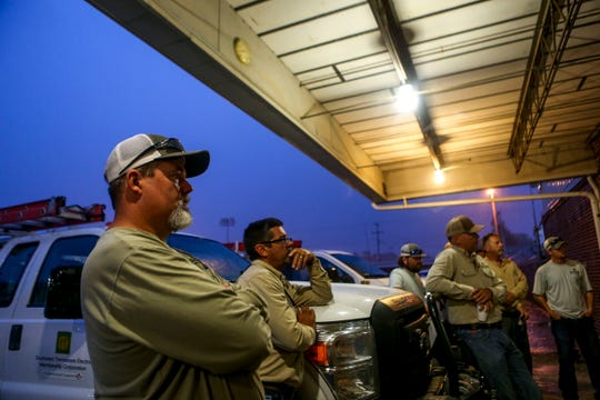 Ken Ralls listens to managers discuss plans for recovery efforts in South Georgia while rain pours outside the overhang at Southwest Tennessee Electric Brownsville Office in Brownsville, Tenn., on Wednesday, Oct. 10, 2018.