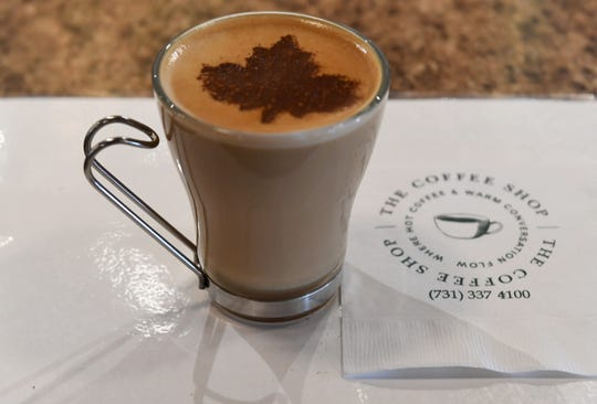 A maple leaf is stencilled onto a flat white inside The Coffee Shop in downtown Humboldt.
