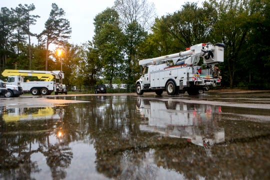 Line workers in two crews depart in a number of work trucks en route to South Georgia where they will assist in Hurricane Michael recovery efforts at Southwest Tennessee Electric Brownsville Office in Brownsville, Tenn., on Wednesday, Oct. 10, 2018.