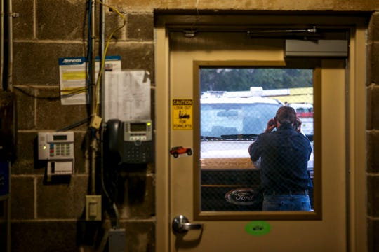 Jesse Jacocks, a mechanic that prepared each truck that will be used in the recovery effort, speaks on the phone before the crews depart for South Georgia at Southwest Tennessee Electric Brownsville Office in Brownsville, Tenn., on Wednesday, Oct. 10, 2018.