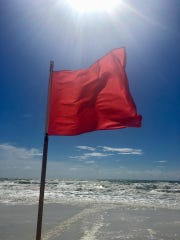 Chad Tindell took this photo of a red flag warning on the beach in Destin, where high surf and dangerous currents preceded Hurricane Michael's landfall in the Florida Panhandle.