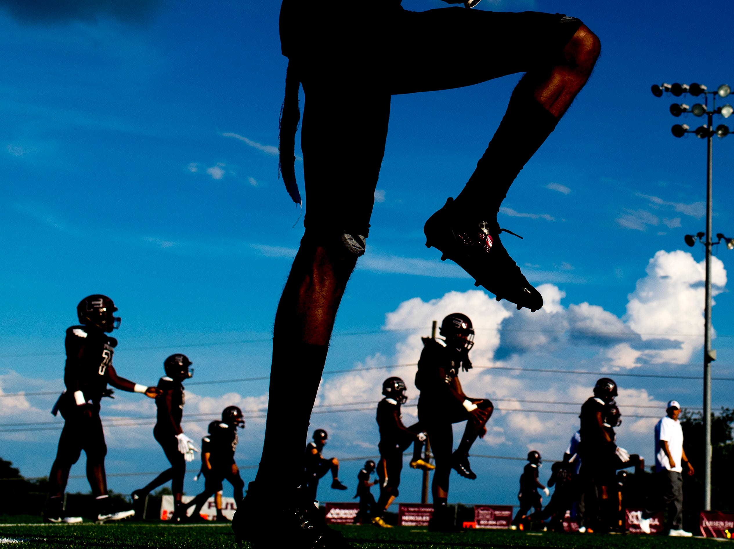 Fulton players warm up during a football game between Fulton and Austin-East at Fulton High School in Knoxville, Tennessee on Friday, September 7, 2018.