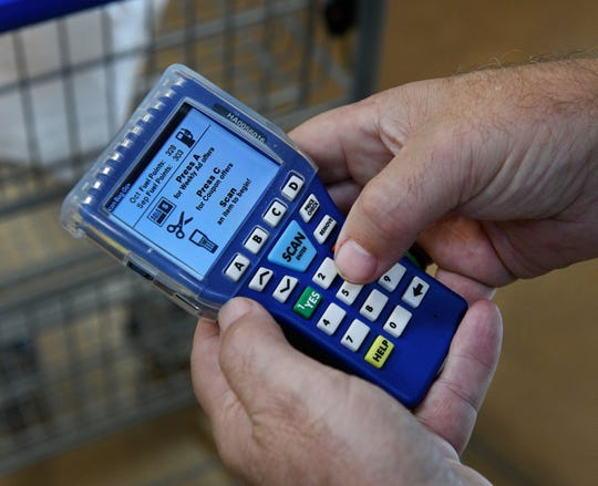 Robert Galvin uses the new hand-scanners at the Kroger in Fountain City on N. Broadway Wednesday, Oct. 10, 2018.