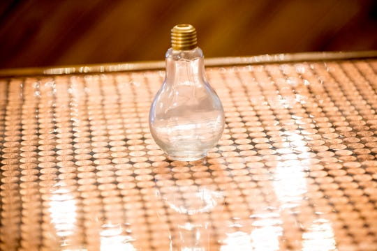 Lightbulb glass is featured at D&S Distilling.