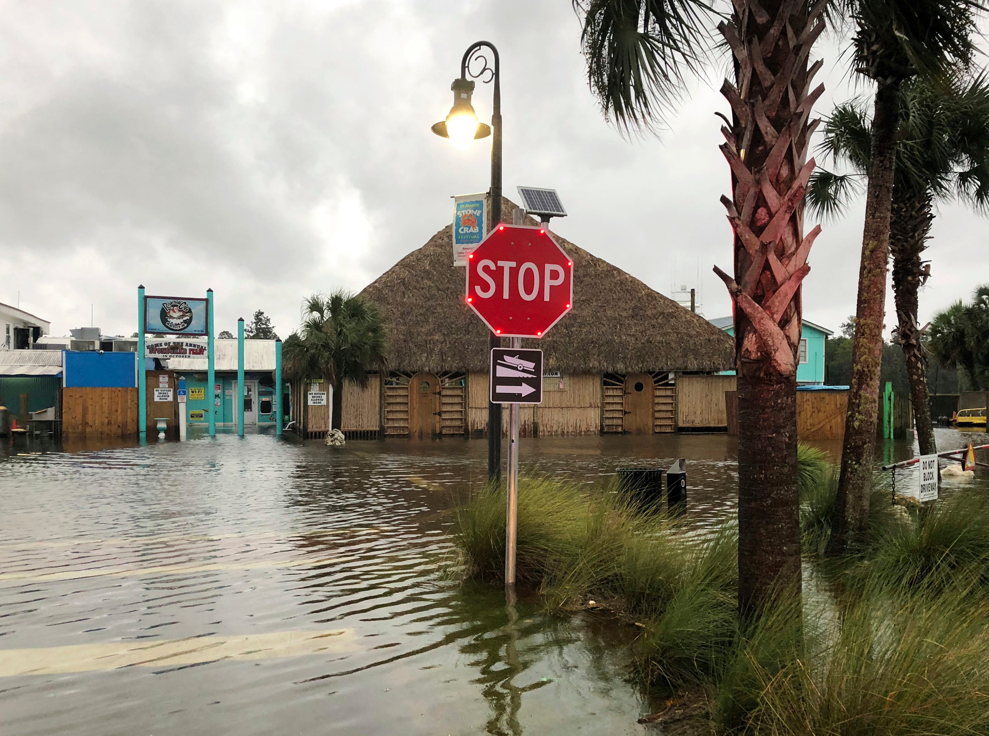 The St. Marks River overflows into the city of St. Marks, Fla., ahead of Hurricane Michael, Wednesday, Oct. 10, 2018.  The hurricane center says Michael will be the first Category 4 hurricane to make landfall on the Florida Panhandle.