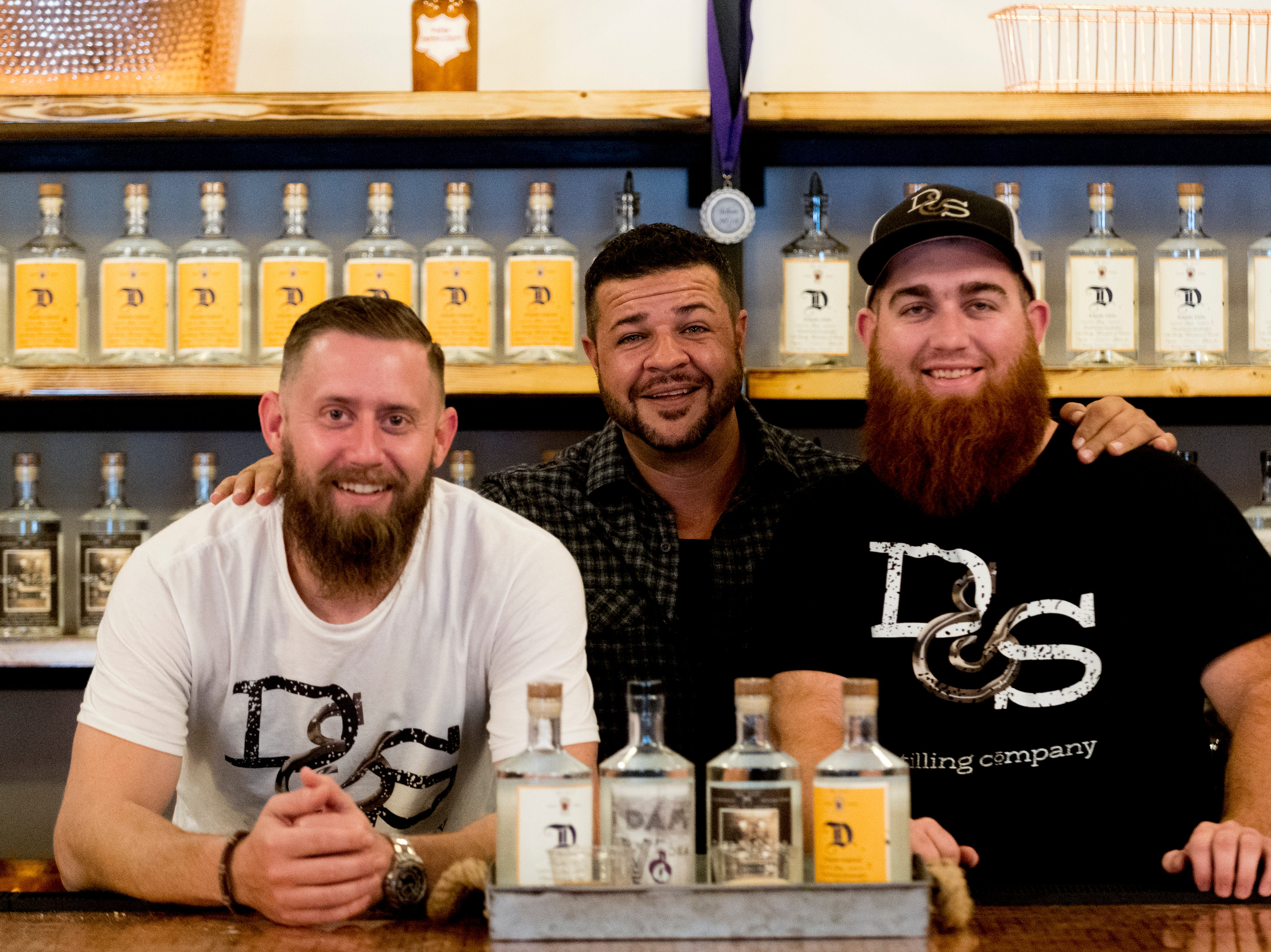 Owner Marcus Delgado, center, with craft ambassador Scott Binckley, left, and Ross Miller, master distiller, right, inside D&S Distilling on 1610 Jenkins Rd. in Sevierville, Tennessee on Tuesday, October 9, 2018. D&S Distilling is TennesseeÕs first completely organic and gluten-free distillery.