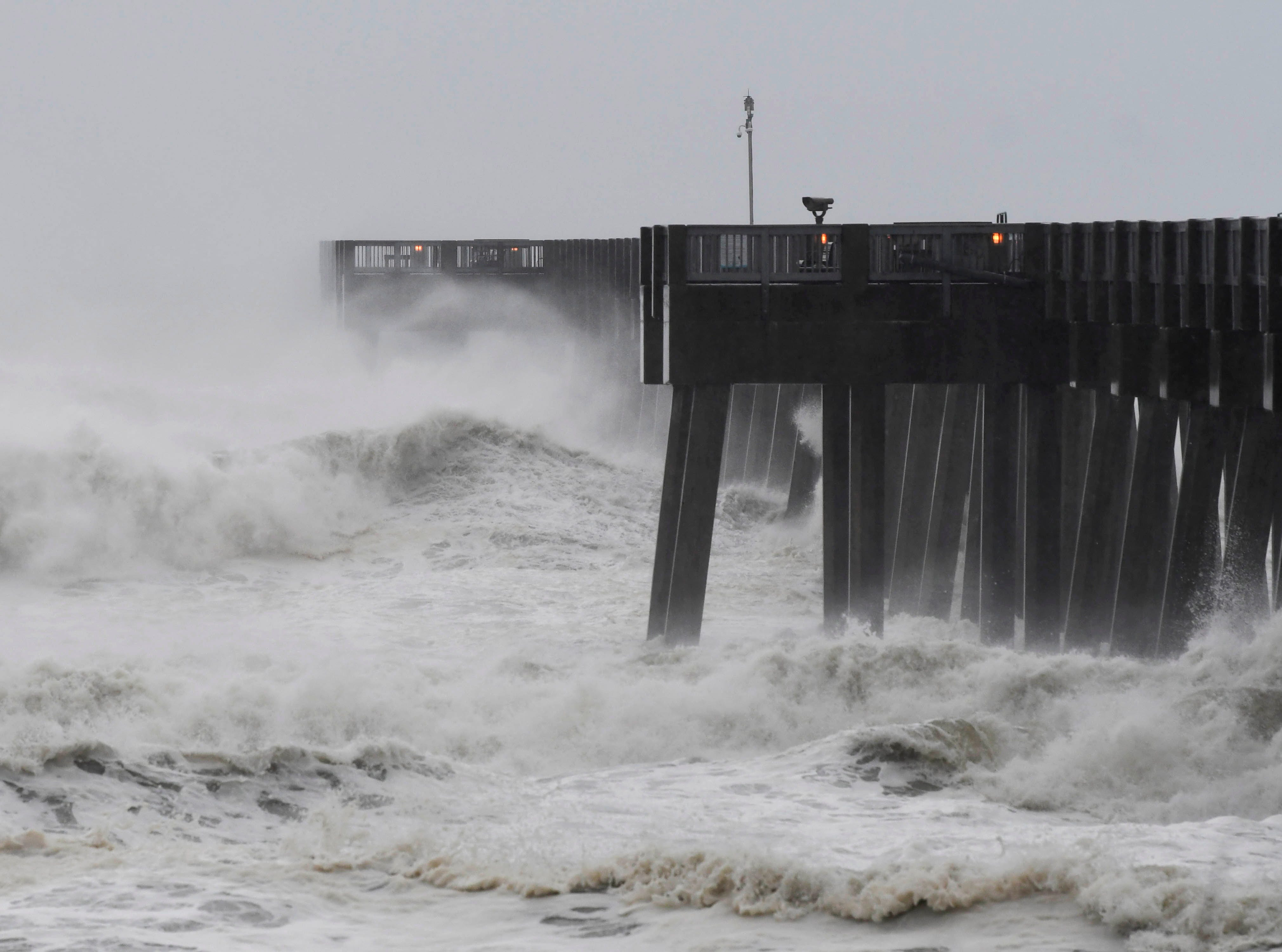 Oct 10, 2018; Panama City, FL, USA; Waves crash over the end of the Panama City Beach Pier as Hurricane Michael approaches.