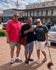 Chad Tindell (left) and his wife, Melissa (right) pose for a photo with JoAnn Bland in Selma, Alabama, where the Tindells took a detour after evacuation from Destin ahead of Hurricane Michael.