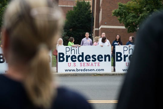 Gov. Phil Bredesen supporters show their support before a U.S. Senate debate between Bredesen and Congressman Marsha Blackburn at the University of Tennessee's Howard H. Baker Jr. Center for Public Policy Wednesday, Oct. 10, 2018. The Senate seat is being vacated by retiring Sen. Bob Corker.