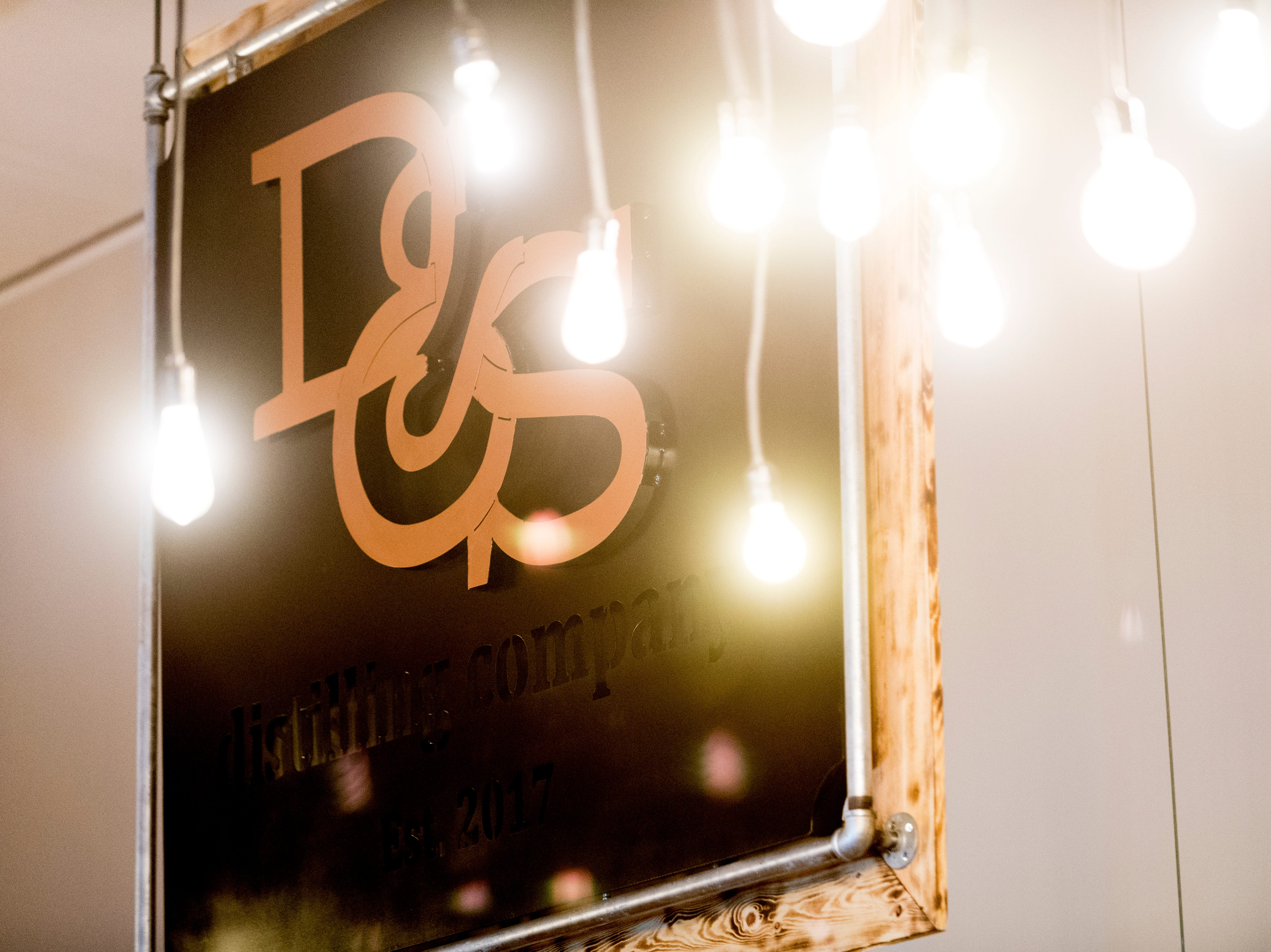 The D&S Distilling logo sign is illuminated over the bar area at their location on 1610 Jenkins Rd. in Sevierville, Tennessee on Tuesday, October 9, 2018. D&S Distilling is TennesseeÕs first completely organic and gluten-free distillery.