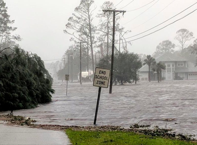 Hurricane Michael formed off the coast of Cuba carrying major Category 4 landfall in the Florida Panhandle. Surge in the Big Bend area, along with catastrophic winds at 155mph. Storm surge floods 20th St in Port St. Joe, Fla., Wednesday, Oct. 10, 2018, after Hurricane Michael makes landfall in the Florida Panhandle.