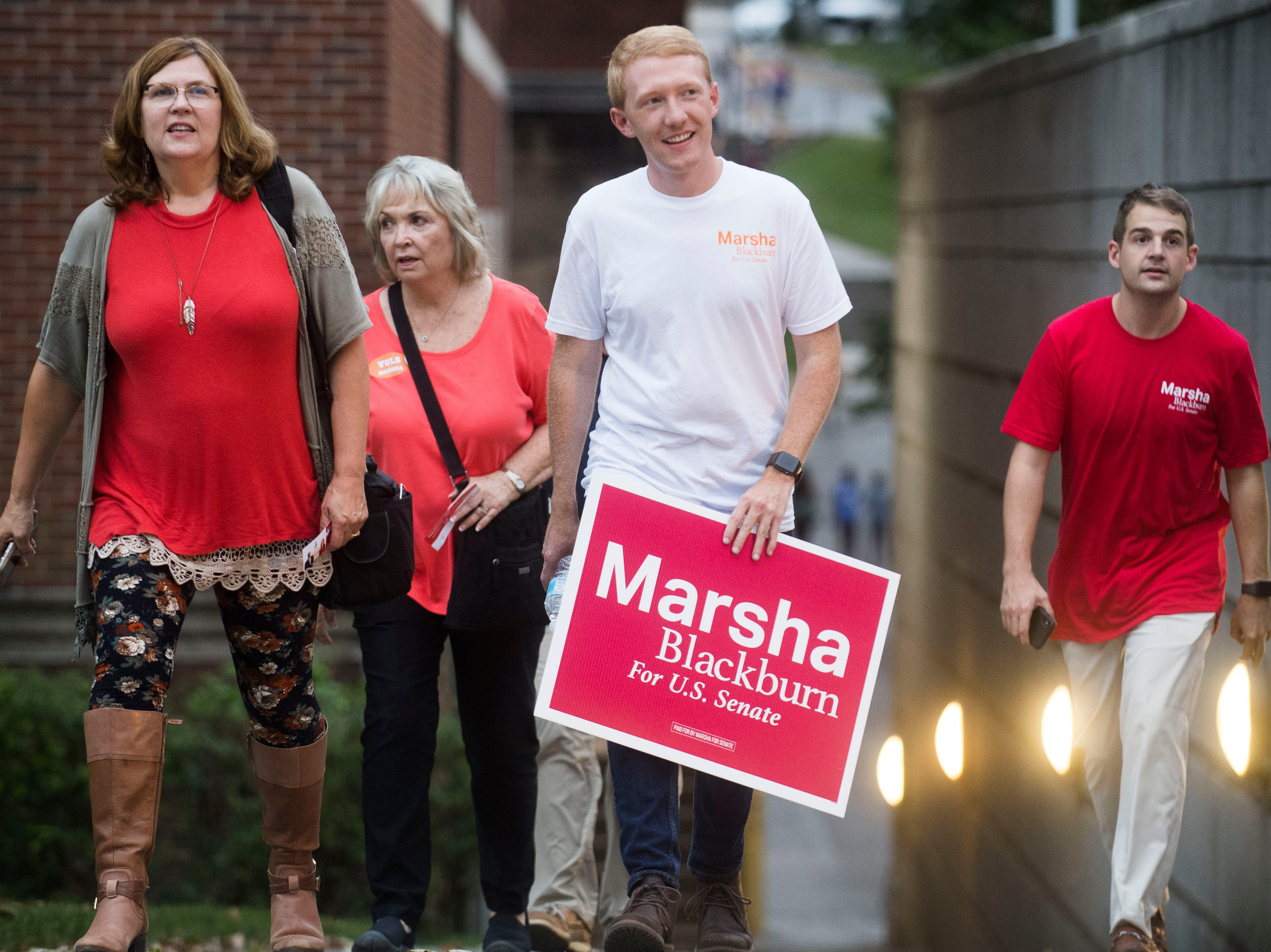 At center Michael Hensley, a Congressman Marsha Blackburn supporter, walks towards Cumberland Avenue before a U.S. Senate debate between Gov. Phil Bredesen and Blackburn at the University of Tennessee's Howard H. Baker Jr. Center for Public Policy Wednesday, Oct. 10, 2018. The Senate seat is being vacated by retiring Sen. Bob Corker.