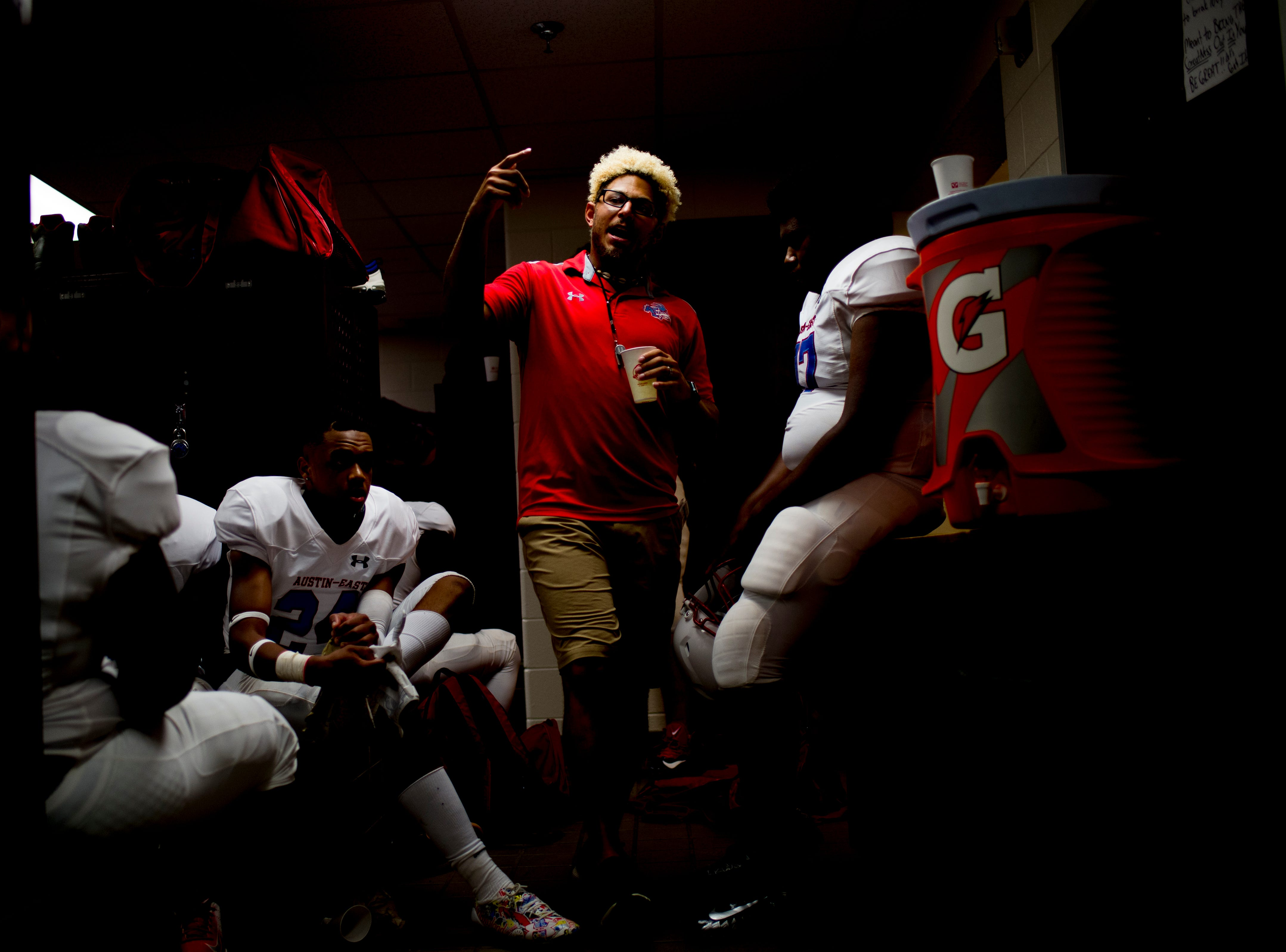 Austin-East Head Coach Jeff Phillips gives a locker room speech before a football game against Fulton at Fulton High School in Knoxville, Tennessee on Friday, September 7, 2018.