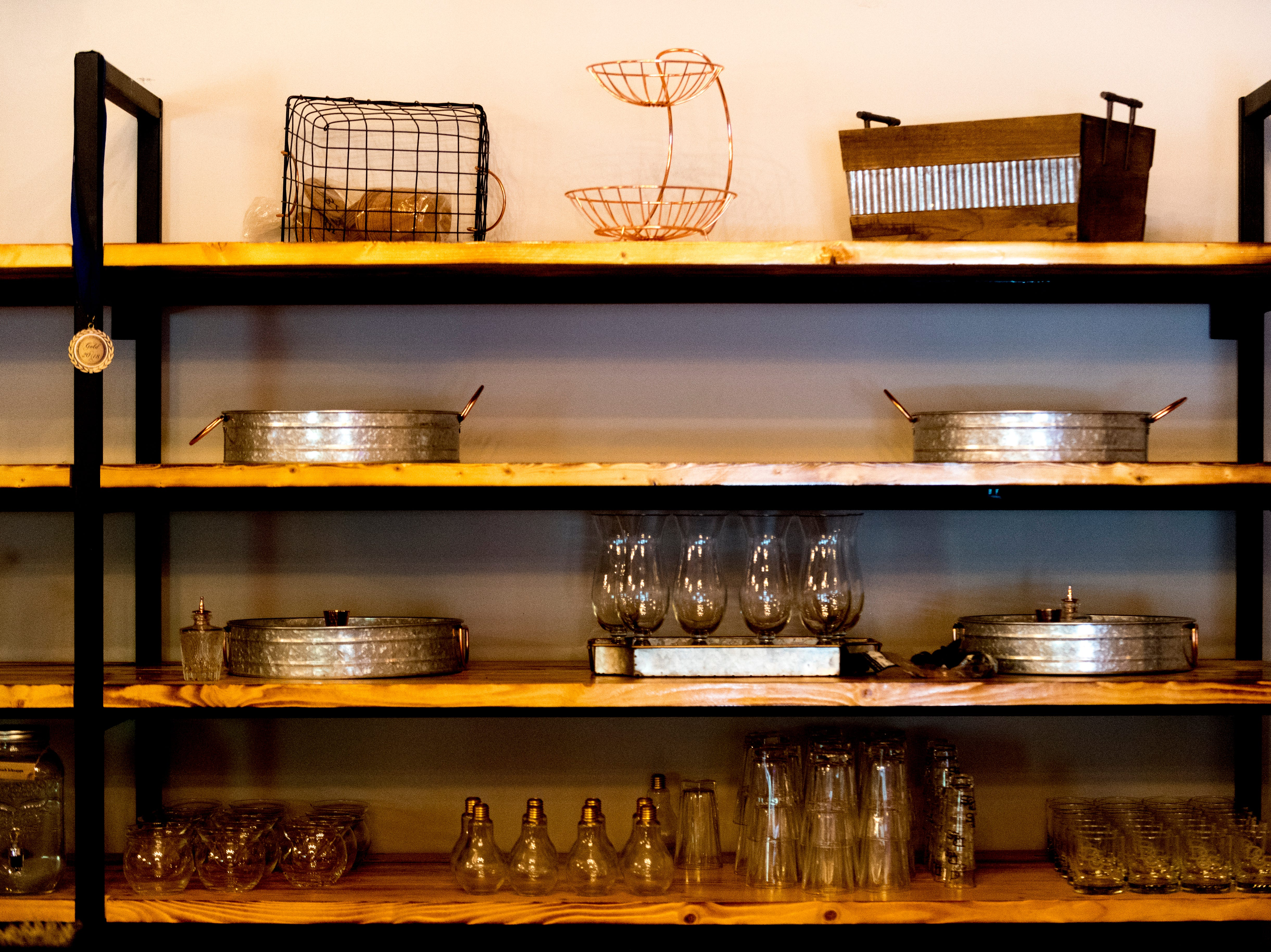 Glasses on a shelf behind the bar inside D&S Distilling on 1610 Jenkins Rd. in Sevierville, Tennessee on Tuesday, October 9, 2018. D&S Distilling is TennesseeÕs first completely organic and gluten-free distillery.