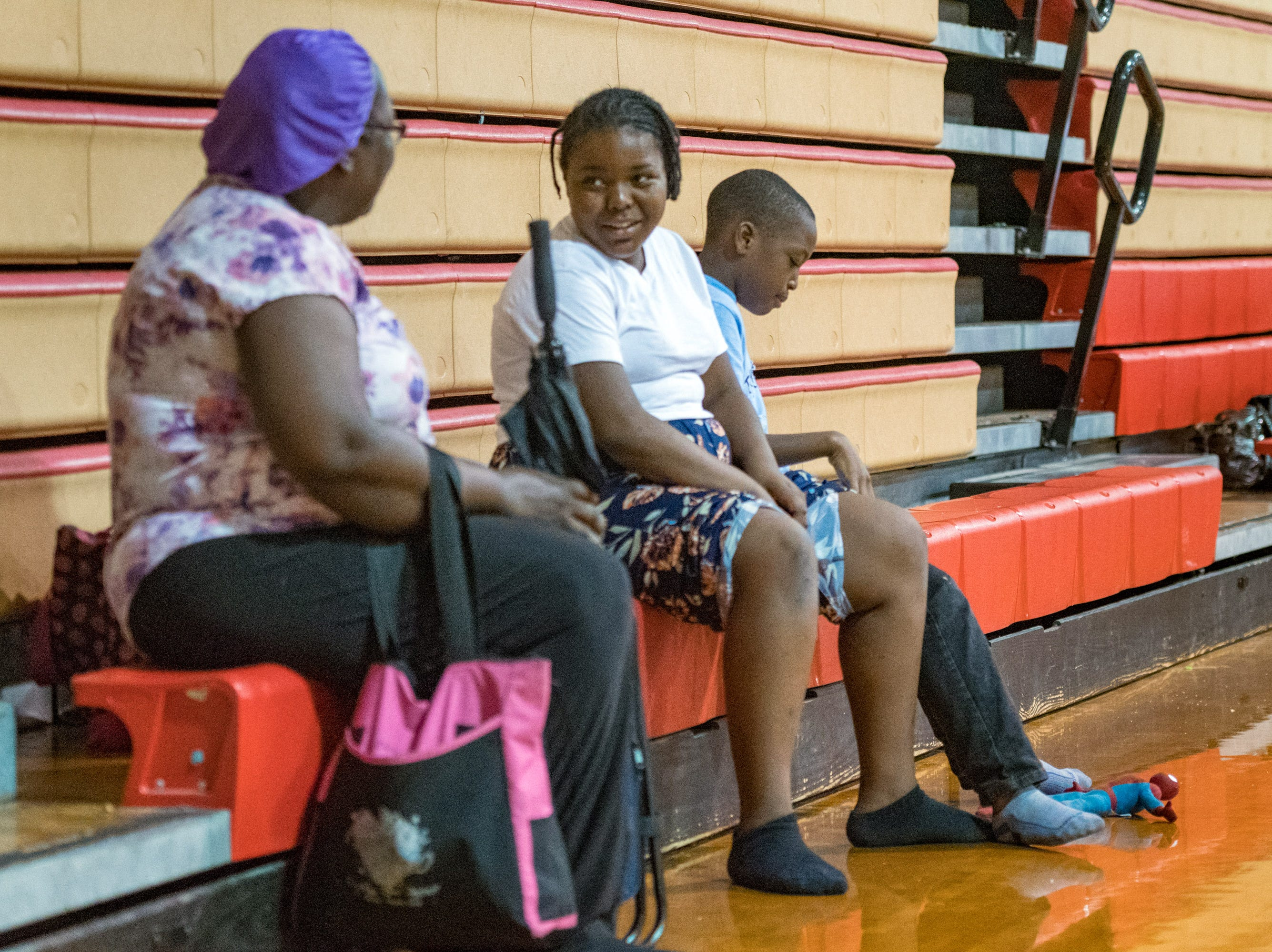 Oct. 10, 2018; Tallahassee, FL, USA; Zamarrie Simmons and her brother Tyler Simmons wait out the storm at the Leon High School Gym as Hurricane Michael approaches the Florida Coast.