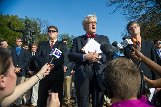 Attorney Daniel McGehee, center, with his client, Alexander P. Broughton, right, addresses the alleged alcohol enema incident during a press conference Tuesday, Oct. 2, 2012, at the University of Tennessee. McGehee claims that UT released false information and denied all allegations that Broughton had engaged in 'butt-chugging' at the Pi Kappa Alpha fraternity house. Broughton, 20, arrived at the University of Tennessee Medical Center emergency room the morning of Sept. 22 unconscious with an injured rectum and a blood-alcohol level of nearly .45, more than five times the legal limit. (ADAM BRIMER/NEWS SENTINEL)