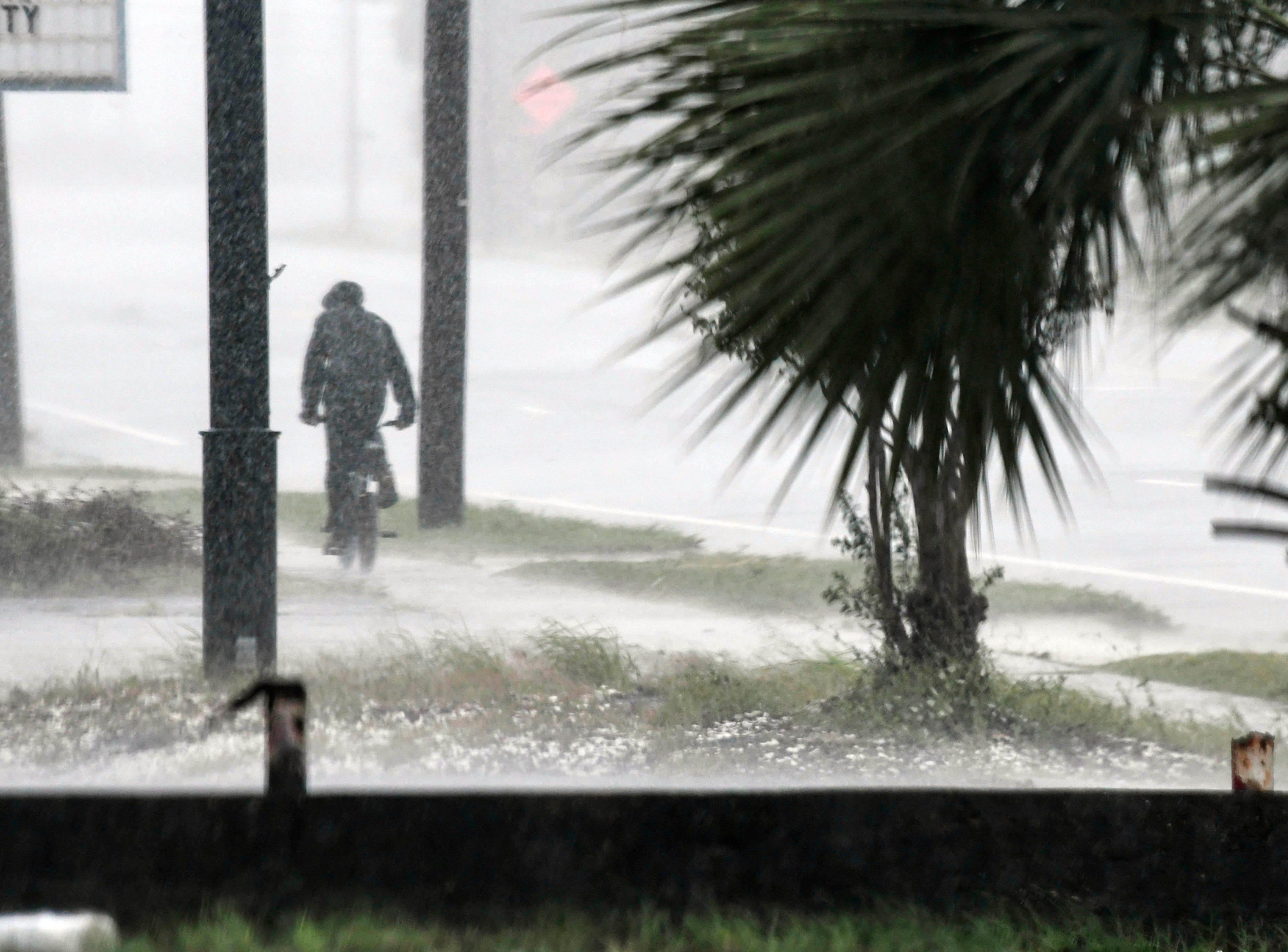 Oct 10, 2018; Panama City, FL, USA; A bicyclist braves the rain as Hurricane Michael approaches Panama City, FL.