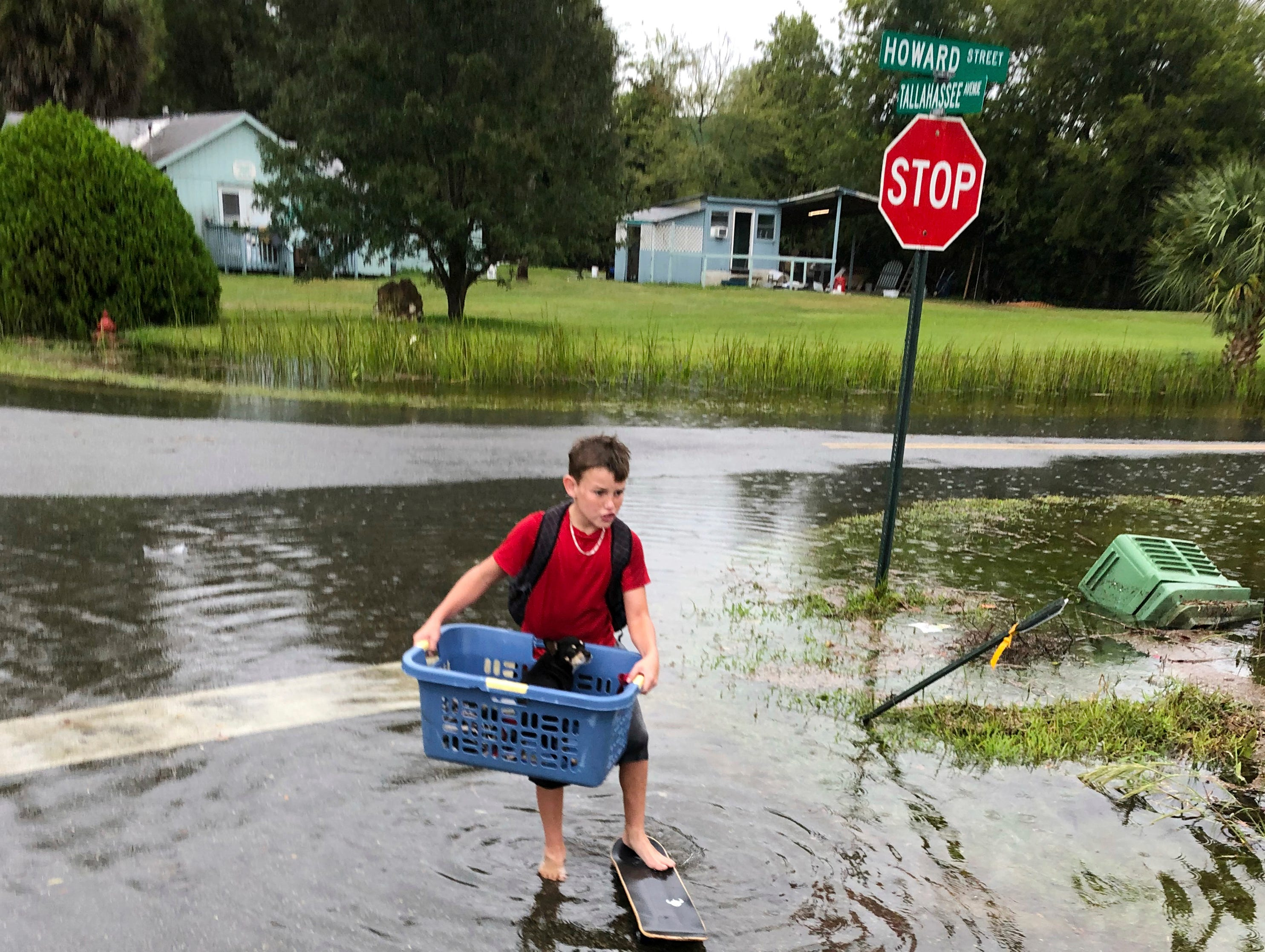 Jayden Morgan, 11, evacuates his home as water starts to flood his neighborhood in St. Marks, Fla, ahead of Hurricane Michael. Gaining fury with every passing hour, Hurricane Michael closed in Wednesday on the Florida Panhandle with potentially catastrophic winds of 150 mph, the most powerful storm on record ever to menace the stretch of fishing towns, military bases and spring-break beaches.