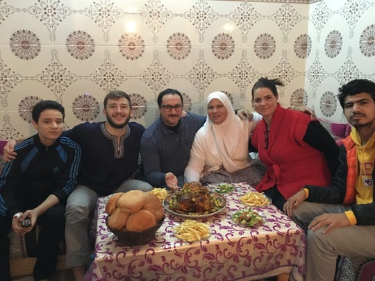 Philip Baites sits with his host family in Morocco.