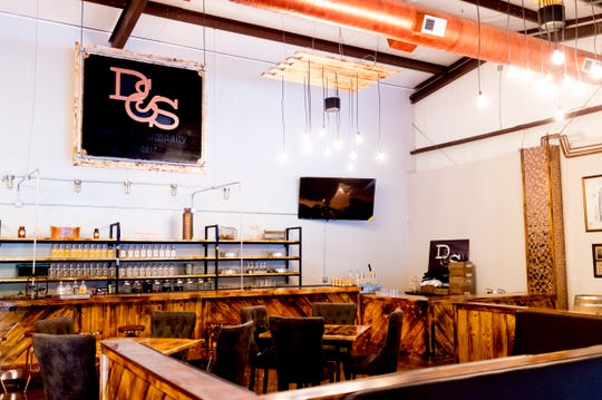 The bar and seating inside D&S Distilling.