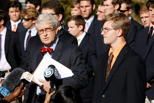 Attorney Daniel McGehee, left, speaks to the media along with his client, Alexander P. Broughton, right,  near the Torchbearer statue at the University of Tennessee on Volunteer Boulevard Tuesday, Sept. 2, 2012. McGehee held the press conference on behalf of his client to help clarify what happened regarding Broughton, a Pi Kappa Alpha fraternity member, at the fraternity house last week. Broughton was taken to the University of Tennessee Medical Center where it was shown that he had a blood alcohol content level of approximately .45, more than five times the legal limit. (ADAM BRIMER/NEWS SENTINEL)