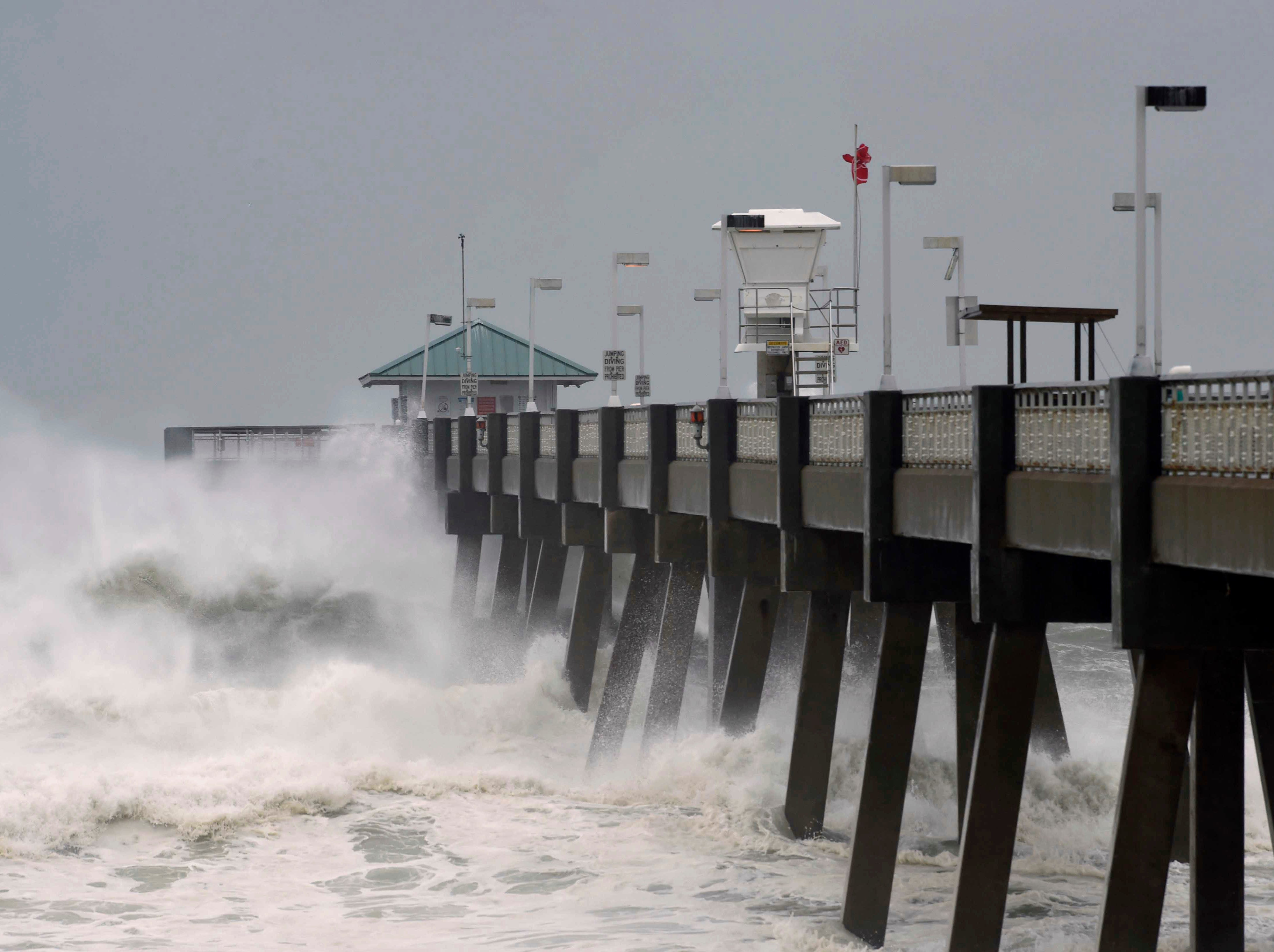Heavy surf from the approaching Hurricane Michael pounds the fishing pier on Okaloosa Island in Fort Walton Beach, Fla., on Wednesday, Oct. 10, 2018.