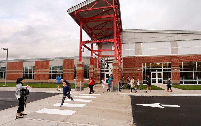 Guests head for home following ribbon cutting ceremonies for West Lafayette Intermediate School Wednesday, October 10, 2018, in West Lafayette. West Lafayette Intermediate School is the first new school building in West Lafayette Community School Corporation since 1961.