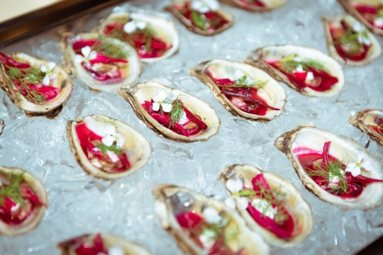 Smoked oysters with creme fraiche, beets and herbs made by Ryan Trahan of Blue Dog Cafe in Lafayette were served during the Louisiana X Nashville media preview event at The Bridge Building in Nashville, Tennessee on Oct. 8, 2018.