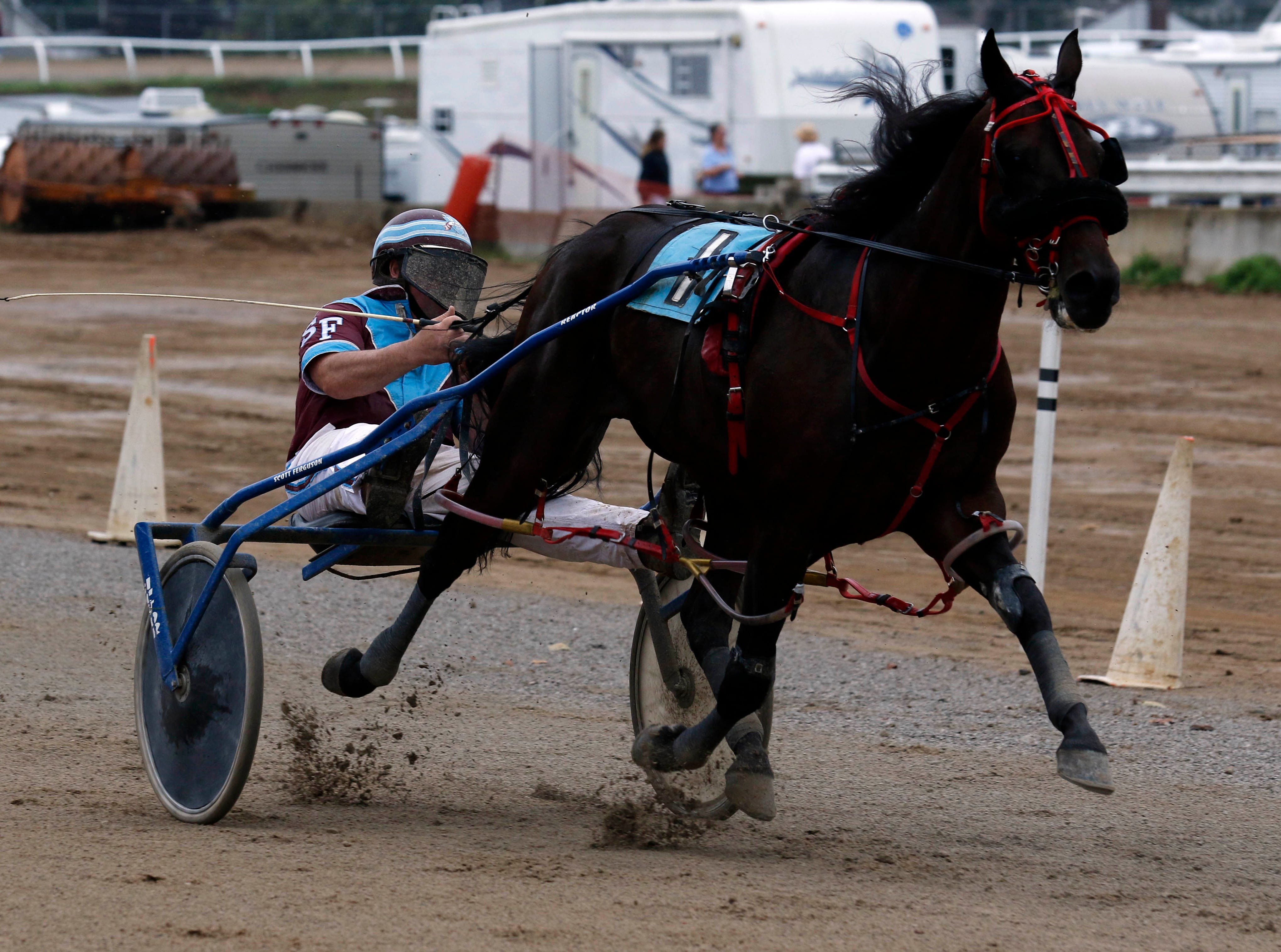 Harness racing took off on the track Wednesday, Oct. 11, 2018, at the Fairfield County Fair in Lancaster.