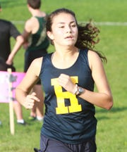 Hartland's Erin Vimr took second with a time of 21:08 in a double-dual cross country meet against Brighton and Howell on Tuesday, Oct. 9, 2018.