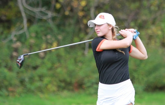 Brighton sophomore Maggie Pietila hits a drive during the Division 1 regional golf tournament at Hartland Glen Golf Club on Wednesday, Oct. 10, 2018.