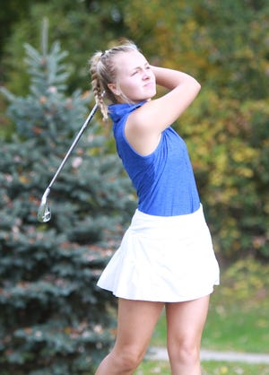 Hartland's Sydney Bradford hits a tee shot during the Division 1 regional golf tournament at Hartland Glen Golf Course on Wednesday, Oct. 10, 2018.