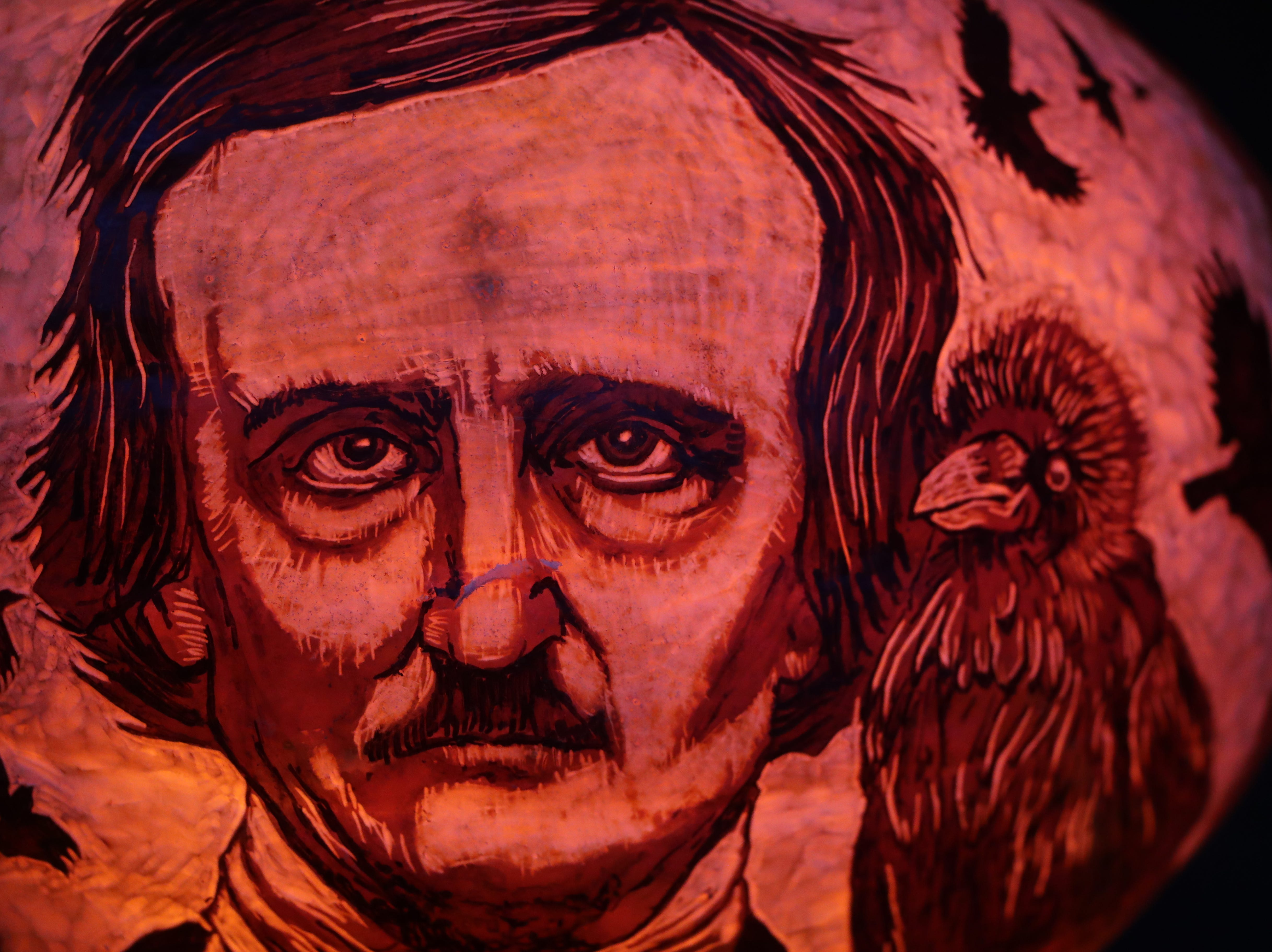 Edgar Allen Poe appears on a pumpkin at this year's Jack O' Lantern Spectacular. Oct. 9, 2018