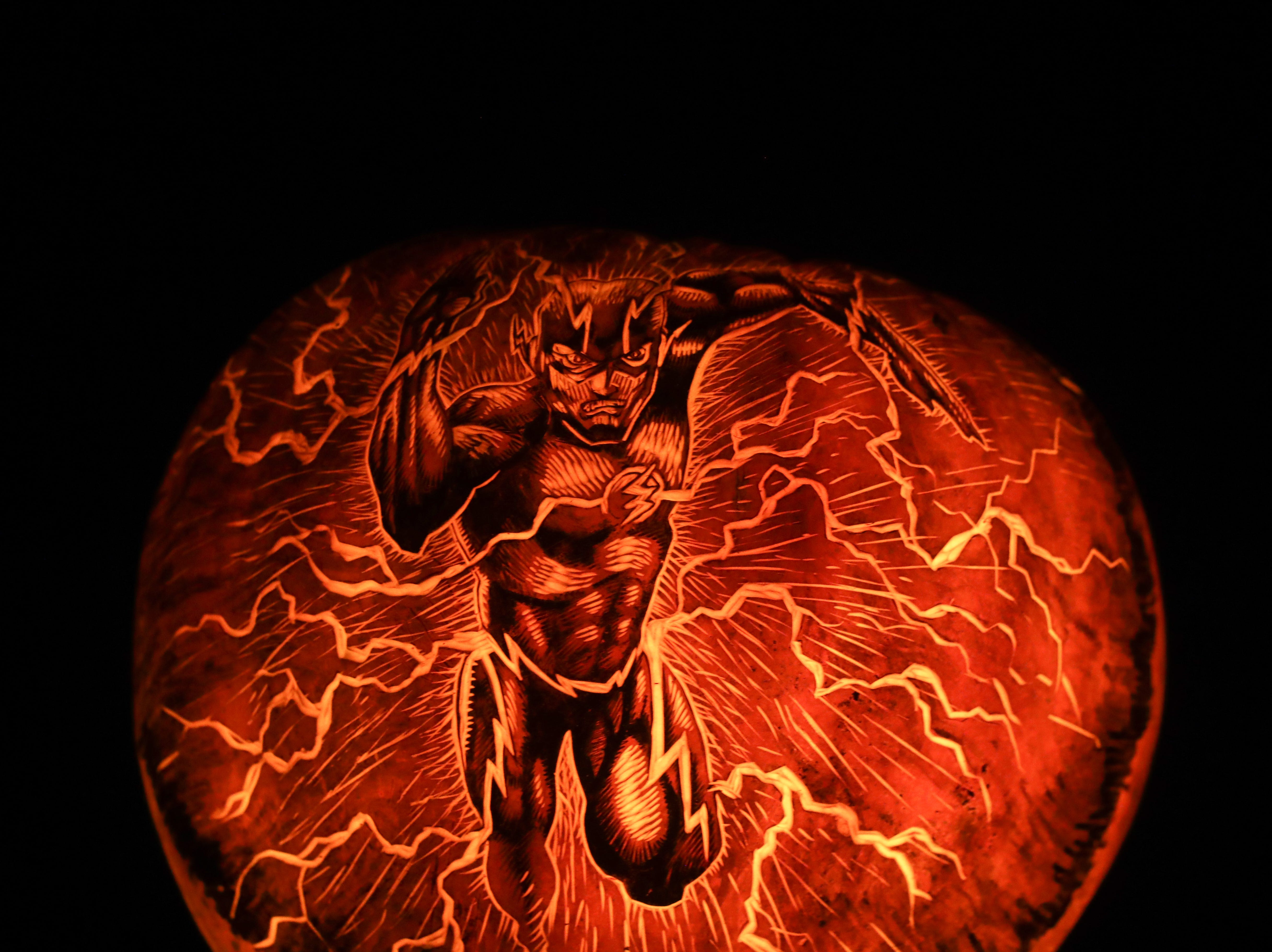 The Flash appears on a pumpkin at this year's Jack O' Lantern Spectacular. Oct. 9, 2018