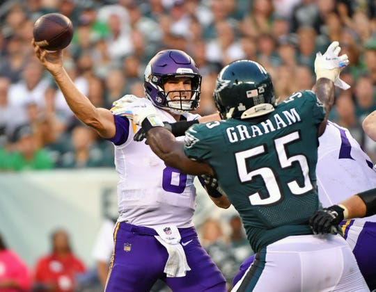 Minnesota Vikings quarterback Kirk Cousins (8) throws a pass under pressure from Philadelphia Eagles defensive end Brandon Graham (55) during the third quarter at Lincoln Financial Field.