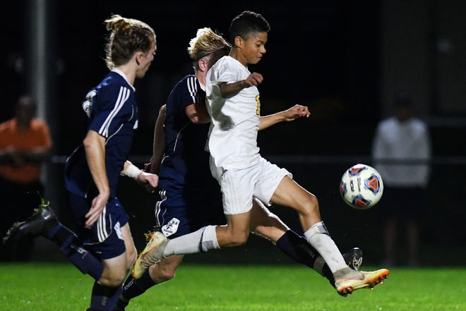 Haslett's Brandon Dixon, right, moves toward the goal during the second half on Tuesday, Oct. 9, 2018, at Okemos High School.