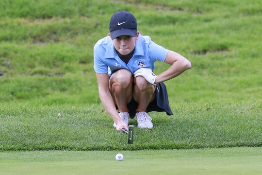 Bay Port's Courtney Koeberl eyes line up the ball on hole No. 4 during the WIAA Division 1 state girls golf tournament Tuesday, Oct. 09, 2018, at University Ridge Golf Course in Madison, Wis.