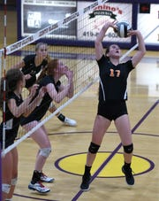 Ashland's Karli Shepherd sets the ball for a Lady Arrows hit during their OCC match at Lexington on Tuesday.