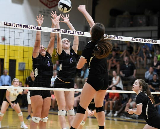 Lexington's Natalie Beer (5) and Mackenzie Raney (6) set up for the Lady Lex block in their OCC title clinching win over Ashland on Tuesday.
