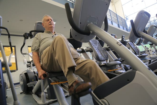 Rich Plodzien works out at the Mansfield YMCA.