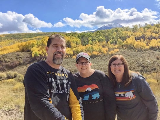 """Bob, Keesha and Susan Furniss on """"Keesha's last bucket list trip to see mountains and aspens in Colorado"""" in 2017."""