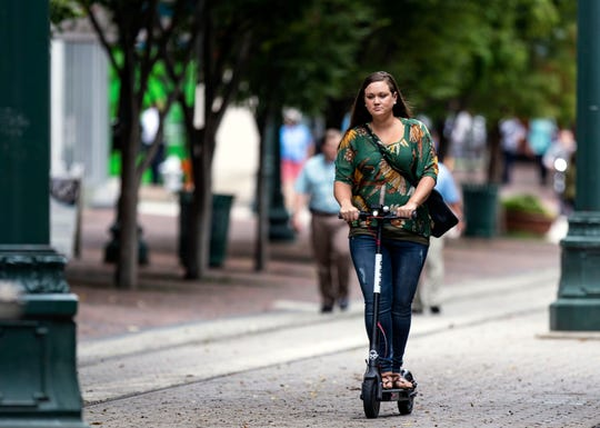 A rider makes her way down South Main Street on a Bird electric scooter in the Downtown Memphis, Tennessee  Wednesday October 10, 2018.